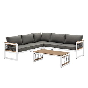 Anoop 4 Piece Rattan Sectional Seating Group with Cushions