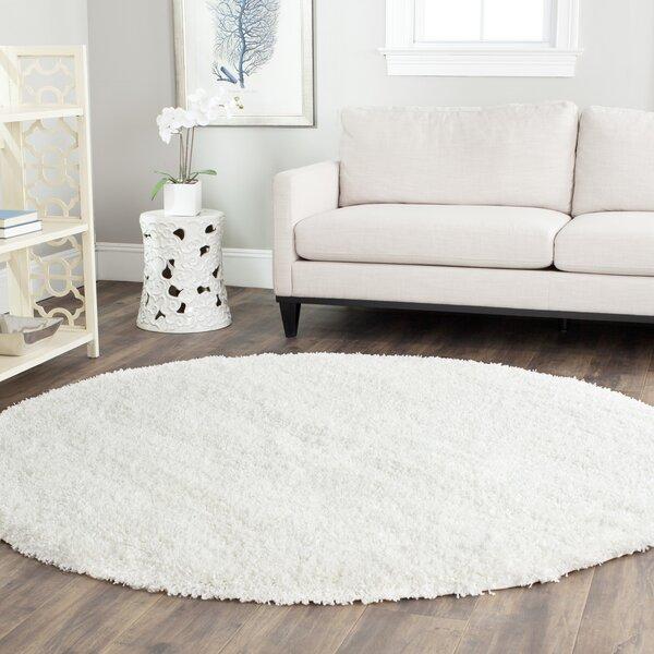 eliza shag white area rug
