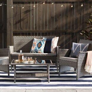 Barnhart 4 Piece Rattan Sofa Seating Group with Cushions