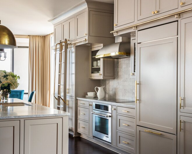 Grey Painted Kitchen Cabinets With Gold Knobs And Pulls.