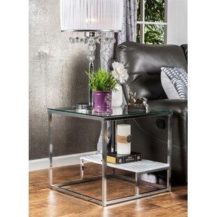 Saniya End Table by Wade L..
