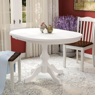 ClipperCover Extendable Solid Wood Dining Table Ophelia & Co.