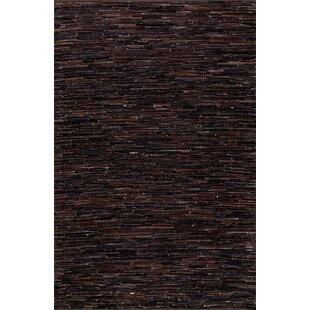 Olaughlin Hand-Woven Dark Brown Area Rug byLoon Peak