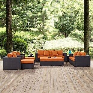 Latitude Run Ryele 9 Piece Rattan Sectional Set with Cushions