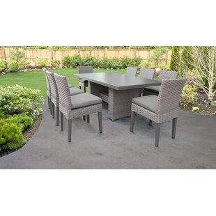 Meeks 9 Piece Dining Set with Cushions