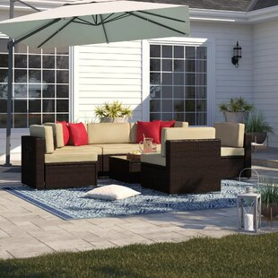 Carmelo 7 Piece Rattan Sectional Set with Cushions