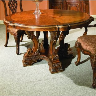 Marguax Round Solid Wood Dining Table by Eastern Legends