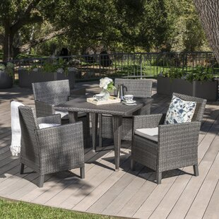 Reidy Outdoor Wicker Rectangular 5 Piece Dining Set with Cushions