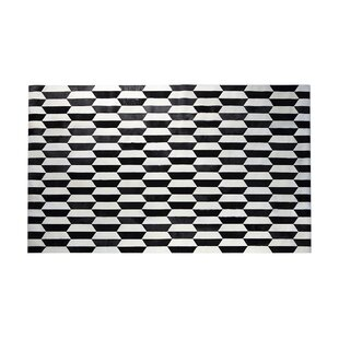 Compare prices Luciano Natural Patchwork Black/White Cowhide Area Rug ByOrren Ellis