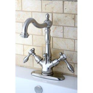 Kingston Brass Tudor Single Hole Bathroom Faucet with Brass Pop-Up Drain