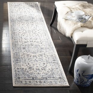 Jase Ivory/Light Blue Area Rug by Charlton Home