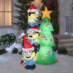 minions decorating tree scene inflatable by the holiday aisle - Inflatable Outdoor Christmas Decorations