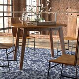 Caracara Round Dropleaf Extendable Dining Table by Trent Austin Design®