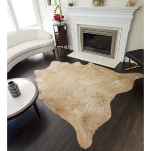 Lettie Hand-Woven Cowhide Tan Area Rug