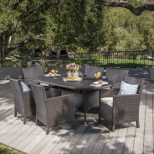 Ivy Bronx Argueta Outdoor Wicker 7 Piece Dining Set with Cushions