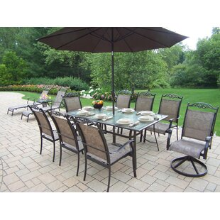 https://secure.img1-fg.wfcdn.com/im/20647371/resize-h310-w310%5Ecompr-r85/4328/43288612/basile-aluminum-framed-9-piece-dining-set-with-umbrella.jpg