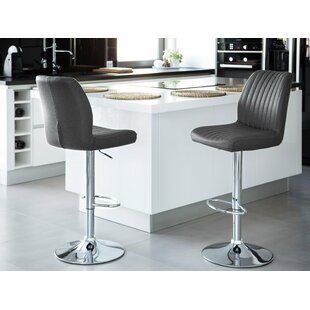 Leatherwood Adjustable Height Swivel Bar Stool by Orren Ellis