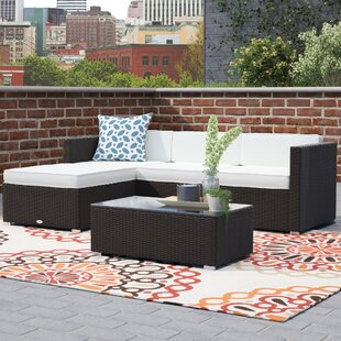 Hazen 5 Piece Rattan Sectional Seating Group with Cushions