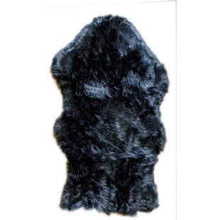Charlotte Hand Woven Faux Sheepskin Black Area Rug