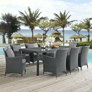 https://secure.img1-fg.wfcdn.com/im/21744585/resize-h310-w310%5Ecompr-r85/5625/56258208/tripp-9-piece-dining-set-with-sunbrella-cushions.jpg