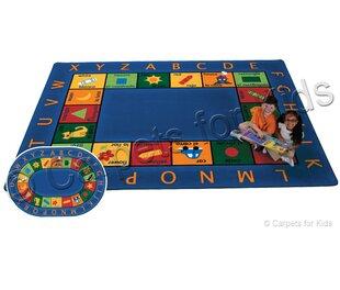 Order Emerado Bilingual Circletime Area Rug ByZoomie Kids