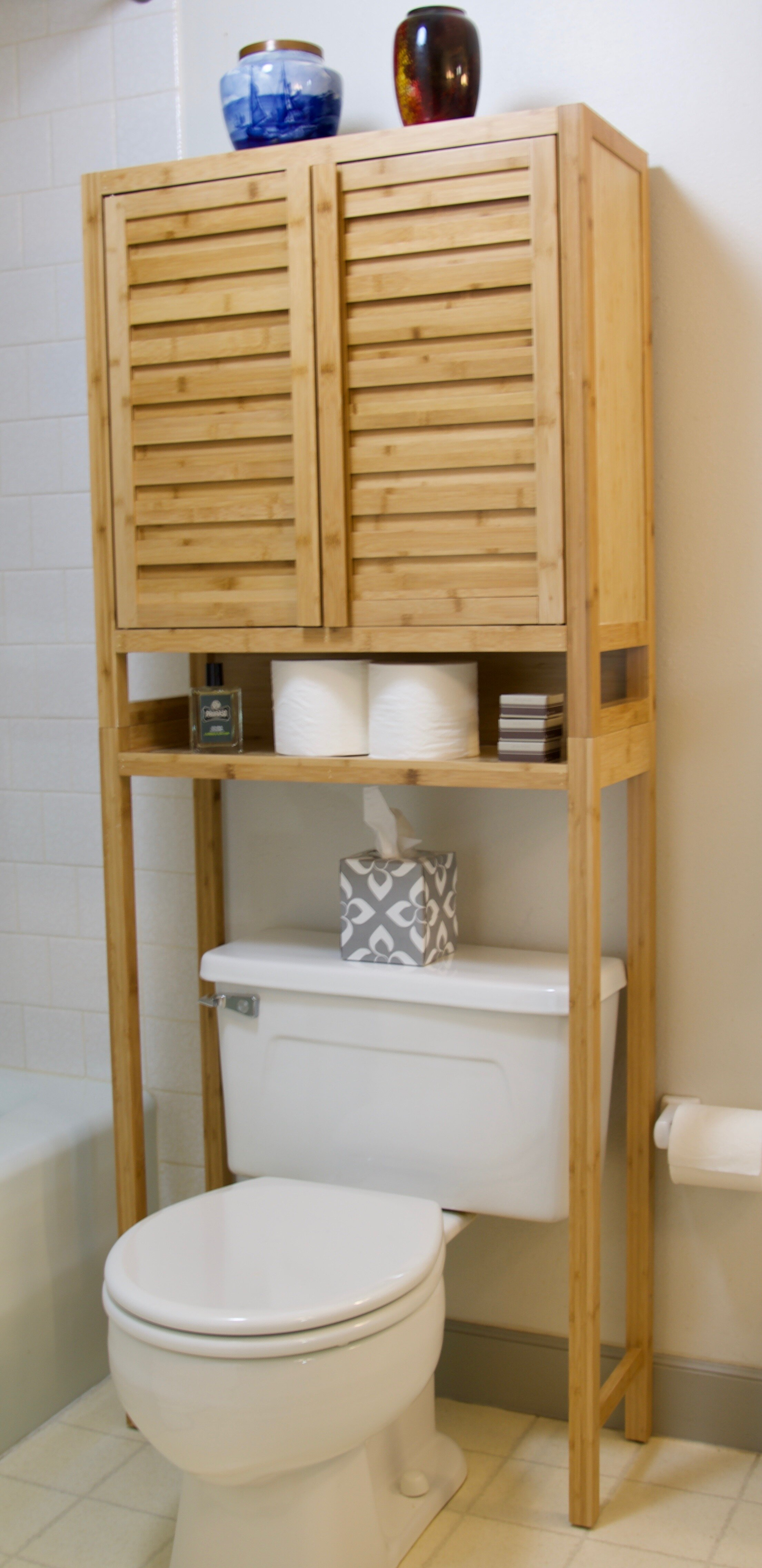 Over the toilet storage in natural wood
