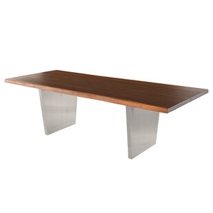 Chiara Dining Table by Orren Ellis Wonderful
