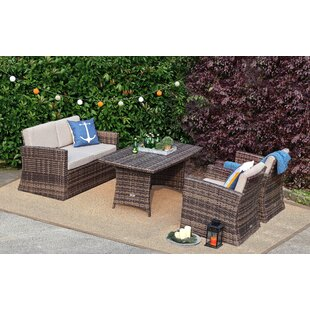 Avi 4 Pieces Rattan Sofa Seating Group with Cushions