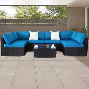 Dennie 7 Piece Rattan Sectional Seating Group with Cushions