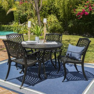 https://secure.img1-fg.wfcdn.com/im/23156365/resize-h310-w310%5Ecompr-r85/4459/44598787/brouwer-outdoor-5-piece-dining-set.jpg