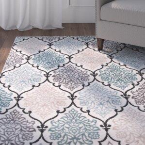 kinsley tealblack area rug