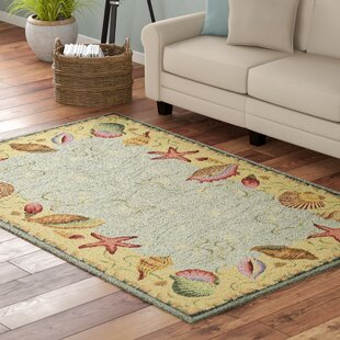 Livia Ocean Surprise Novelty Rug by Highland Dunes