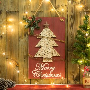Christmas tree wall hanging wayfair wooden christmas tree sign wall dcor aloadofball Image collections