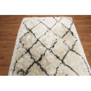 Order Eola Contemporary Hand-Tufted 5' x 8' Ivory/Black Area Rug By Isabelline