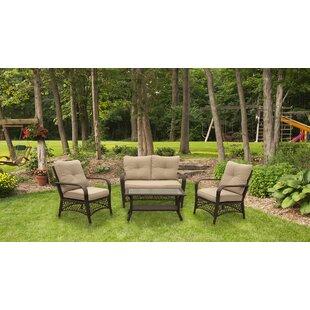 Tanisha 4 Piece Rattan Sofa Seating Group with Cushions
