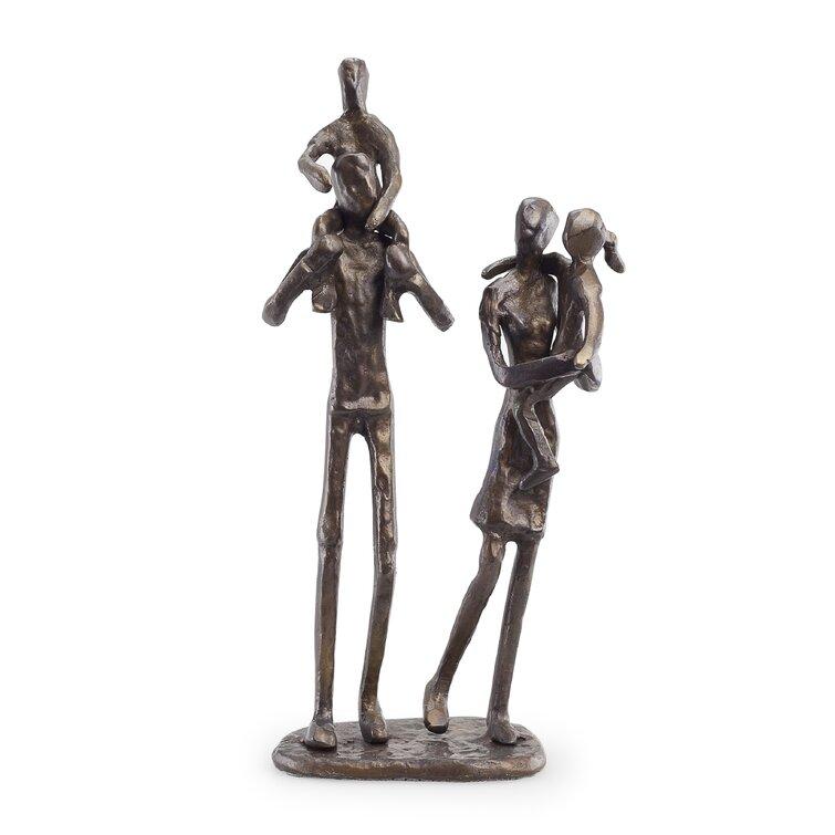 Parents Carrying Children Figurine