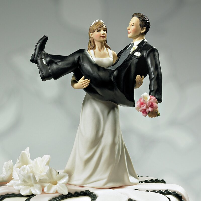 Bride Holding Groom Cake Topper