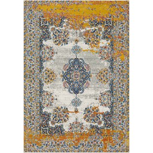 Comparison Leonardo Distressed Traditional Blue/Yellow Area Rug By Bungalow Rose