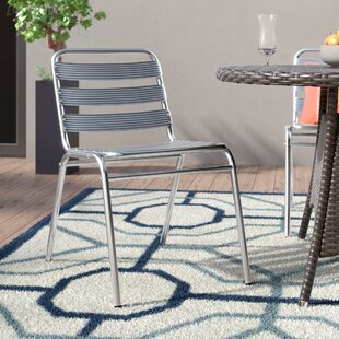 Nunez Commercial Stacking Patio Dining Chair by Orren Ellis