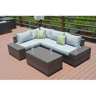 Michell 7 Piece Rattan Sectional Seating Group with Cushions