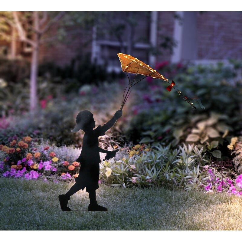Boy Plating With Kite Garden Stake