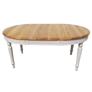 One Allium Way Felicien Oval Solid Wood Dining Table