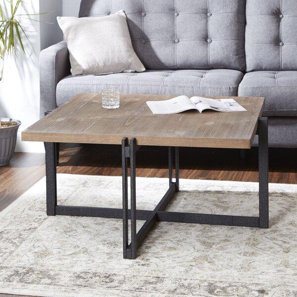 Ivy Bronx Baran Distressed Coffee Table | Wayfair