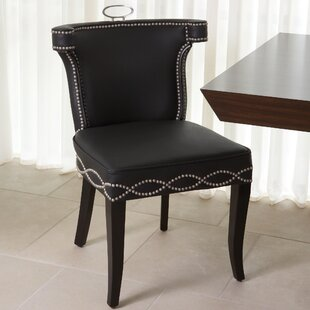 Be Seated in Chic Comfort Casino Genuine Leather Upholstered Dining Chair Global Views