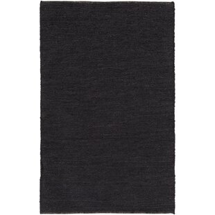 Find the perfect Zellers Hand-Woven Black Area Rug ByGeorge Oliver