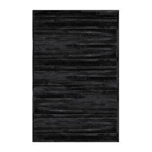 Buy clear Sathvik Hand-Woven Cowhide Black Area Rug By 17 Stories
