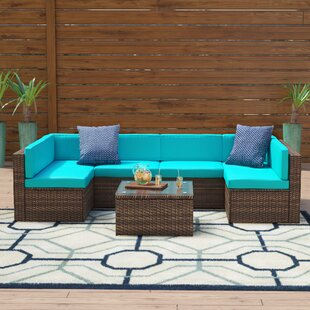 Shelbie 7 Piece Rattan Sectional Seating Group with Cushions