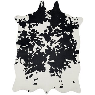 Bargain Faux Hide Hand-Tufted Black/White Area Rug By Safavieh
