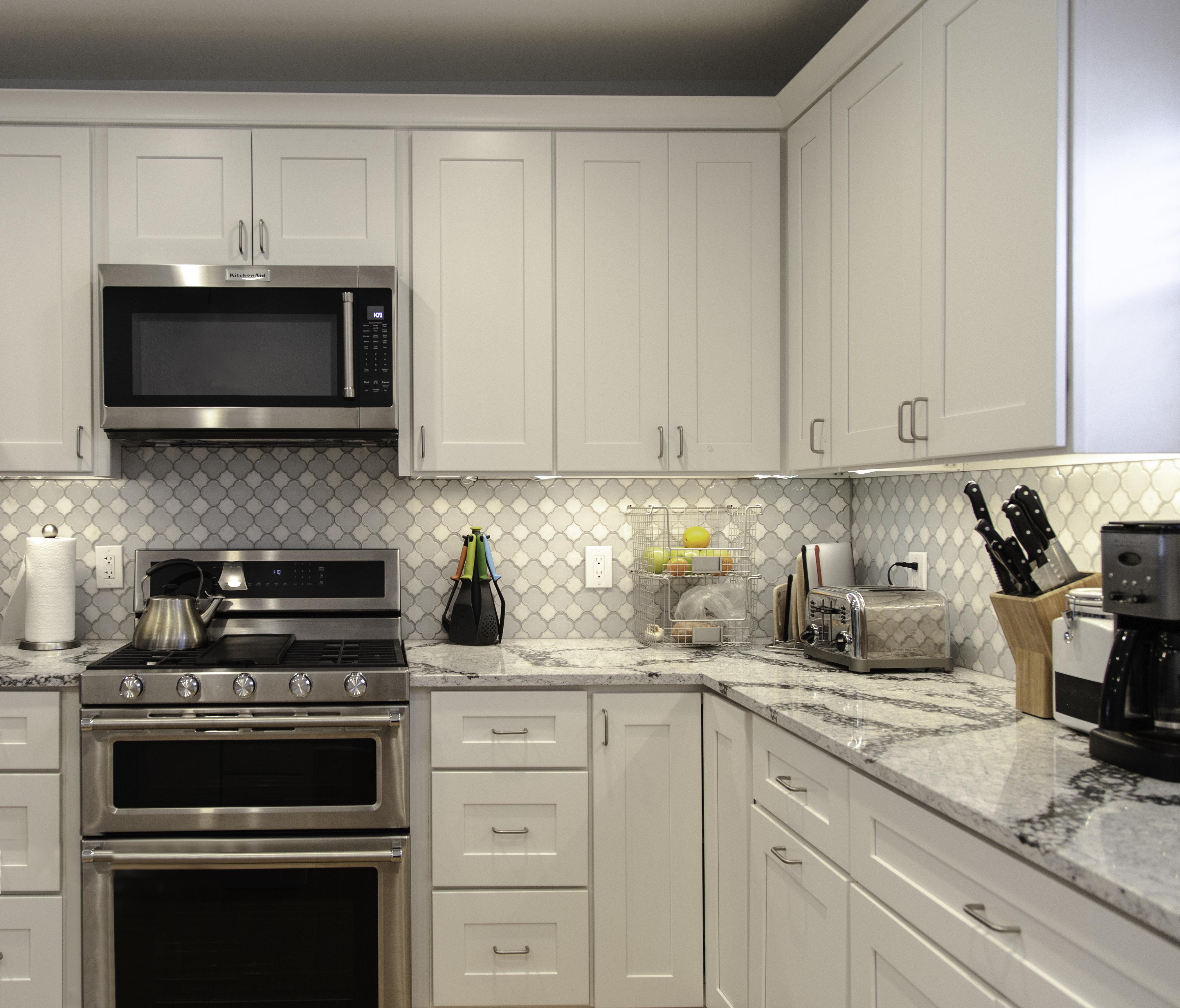 Ebern Designs Frits Fully Assembled 24x12x12 In Shaker Style Kitchen Bridge Wall Cabinet 2 Door In White Wayfair