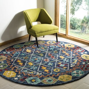 Bobigny Southwestern Hand-Tufted Navy Area Rug by Loon Peak